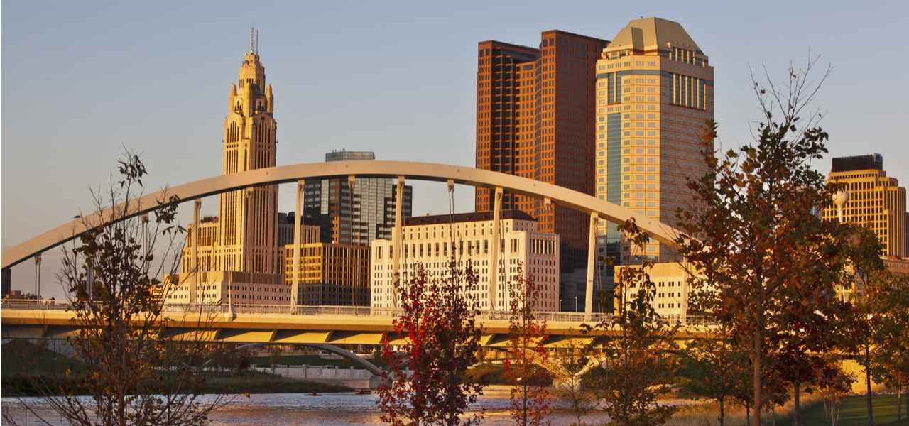 The skyline of Columbus, Ohio, in the fall, with the Main Street Bridge in the foreground