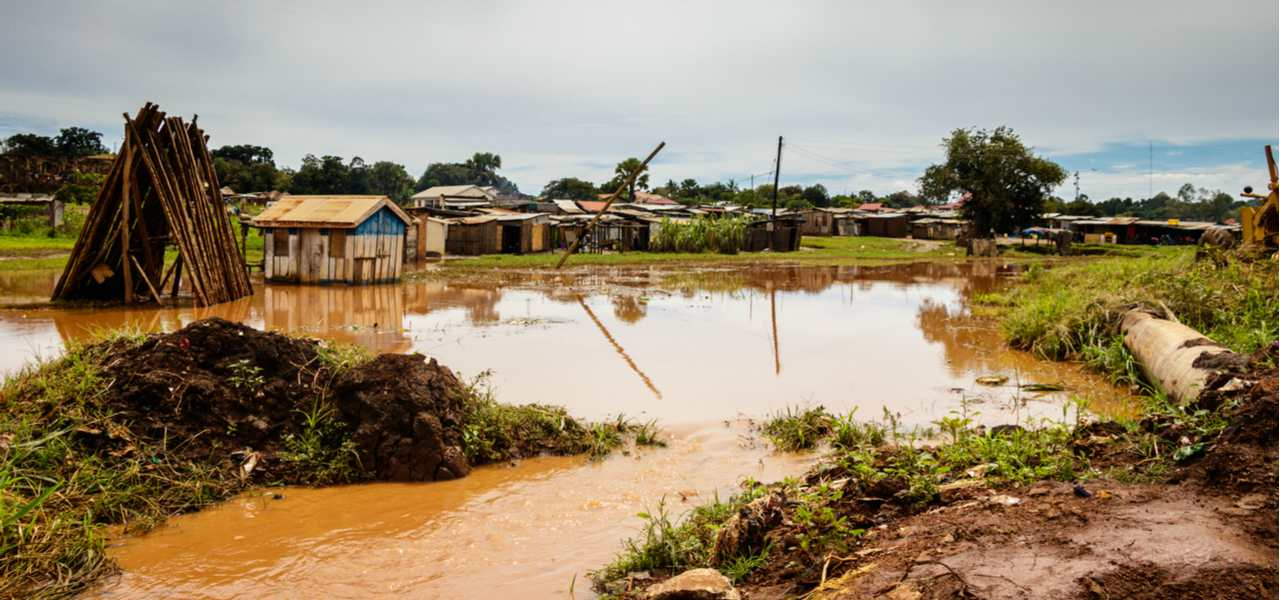 Several houses sit alongside roads washed away by the 2008 flood in the Democratic Republic of the Congo