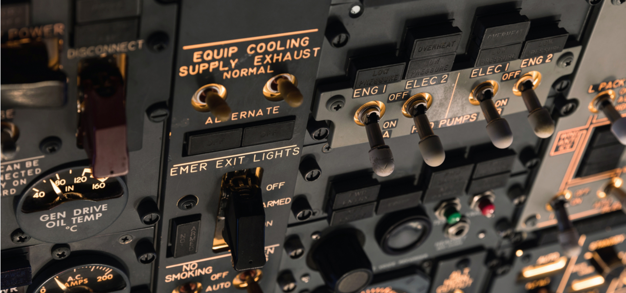 Detailed closeup of aircraft control switches-and-gauges