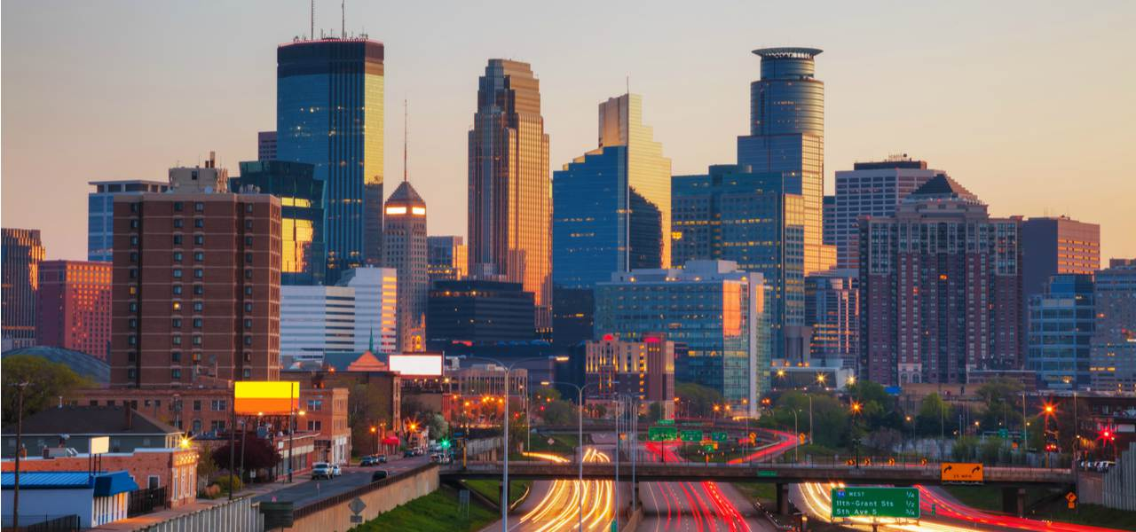 Downtown Minneapolis' skyscrapers and highways at dawn