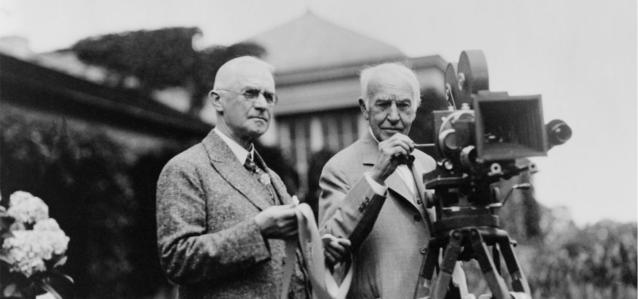 Thomas Edison and George Eastman standing with motion picture camera in 1925