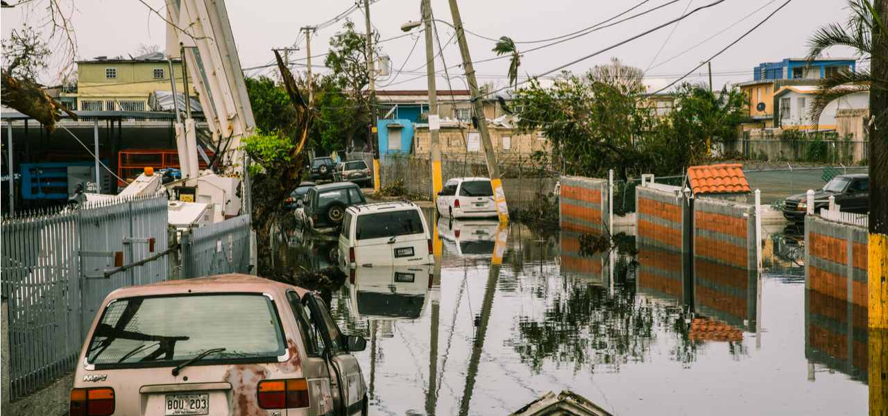 Cars lie half-submerged in the flooded streets of San Juan, Puerto Rico, after Hurricane Maria in 2017