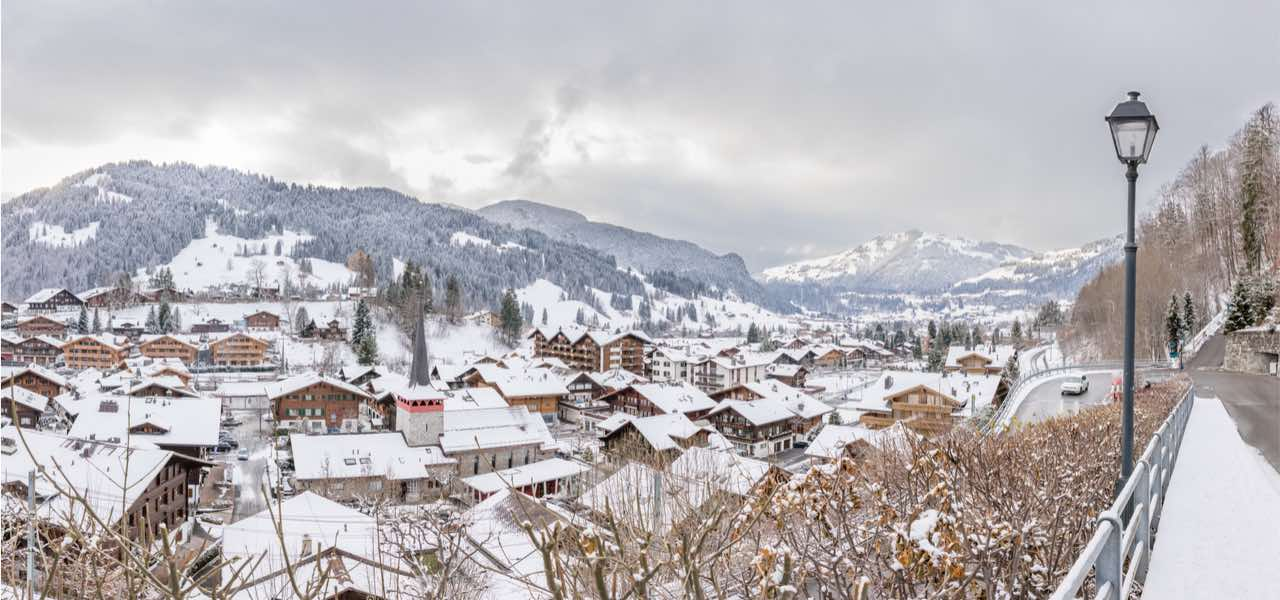 The village of Gstaad in the Swiss Alps under the snow during winter.
