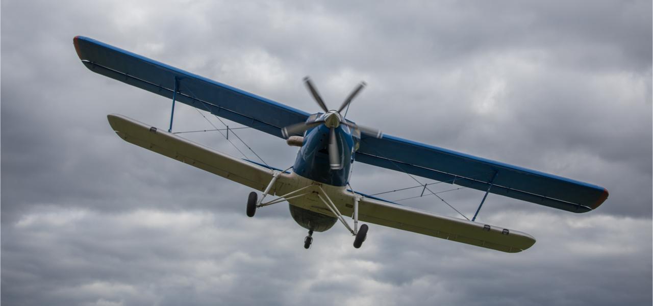 Vintage propeller plane in flight