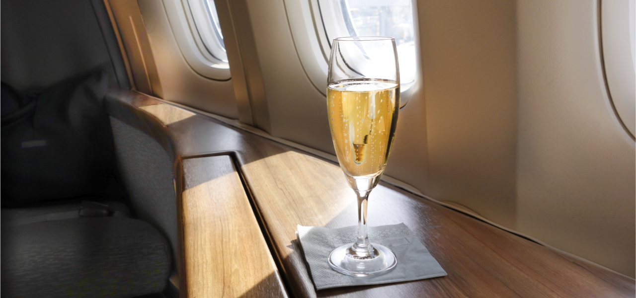 Glass of champagne inside private jet
