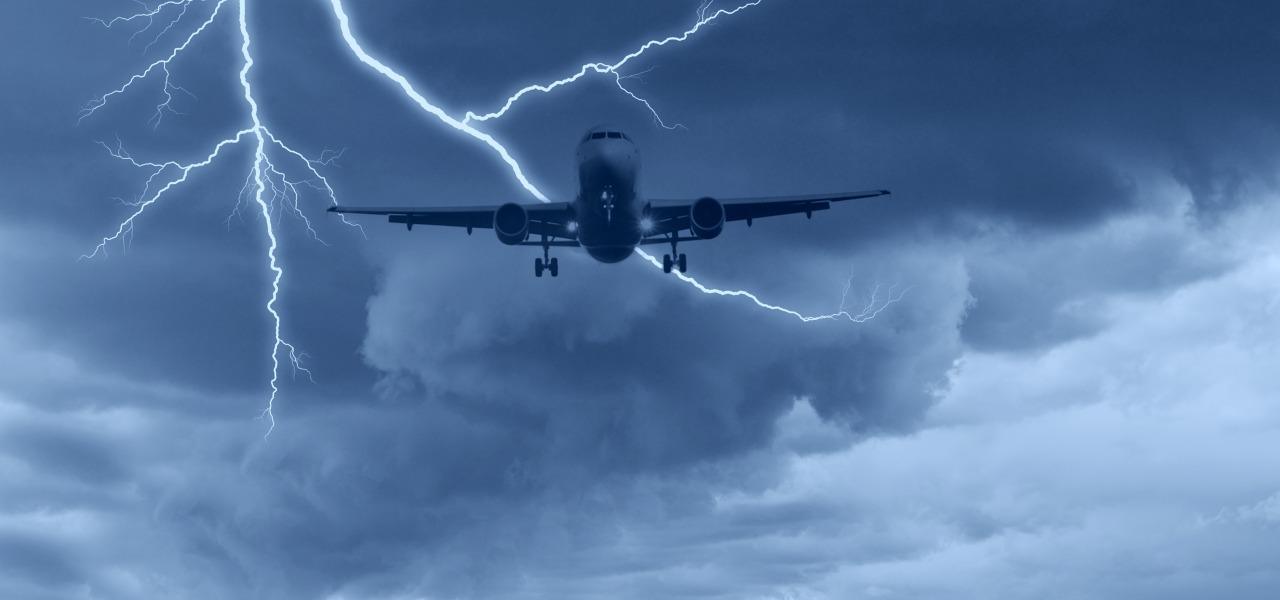 Modern jet in flight in flight during a lightning storm