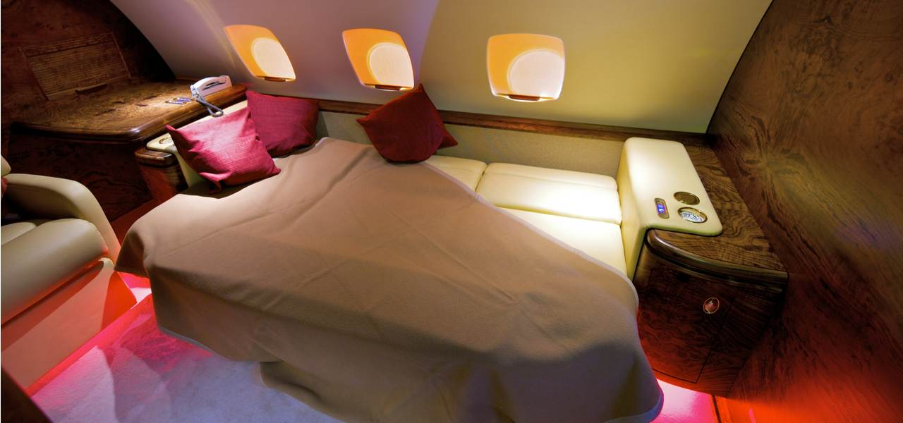 A luxurious bedroom on board a private jet