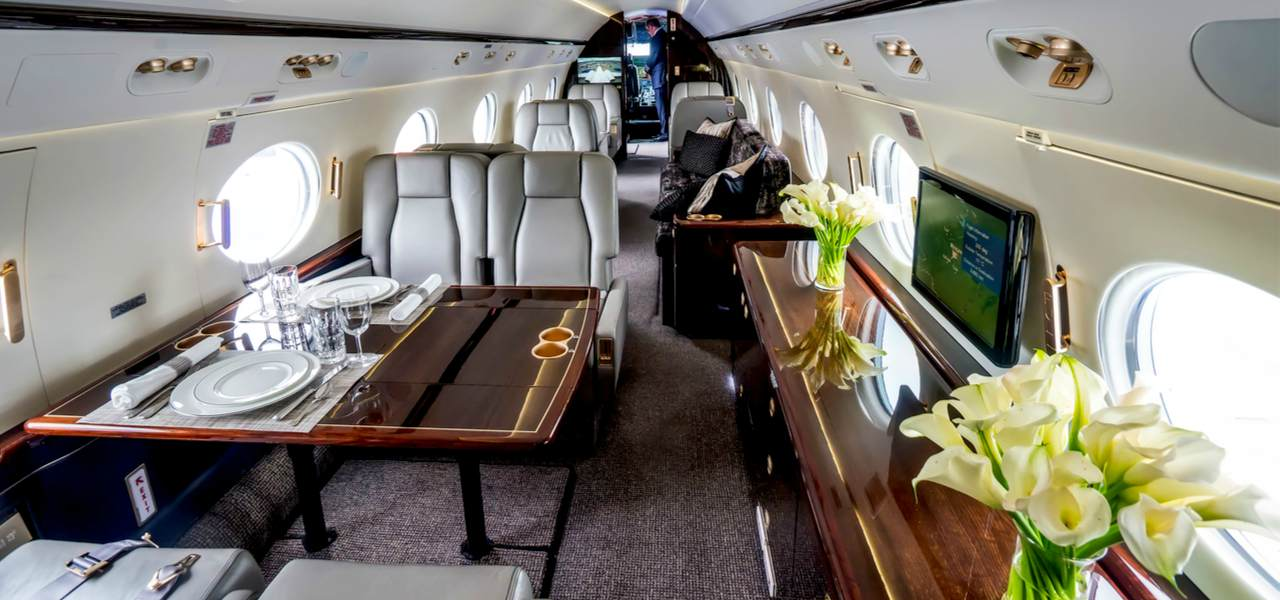 Luxury interior with wooden tables in the modern private business jet