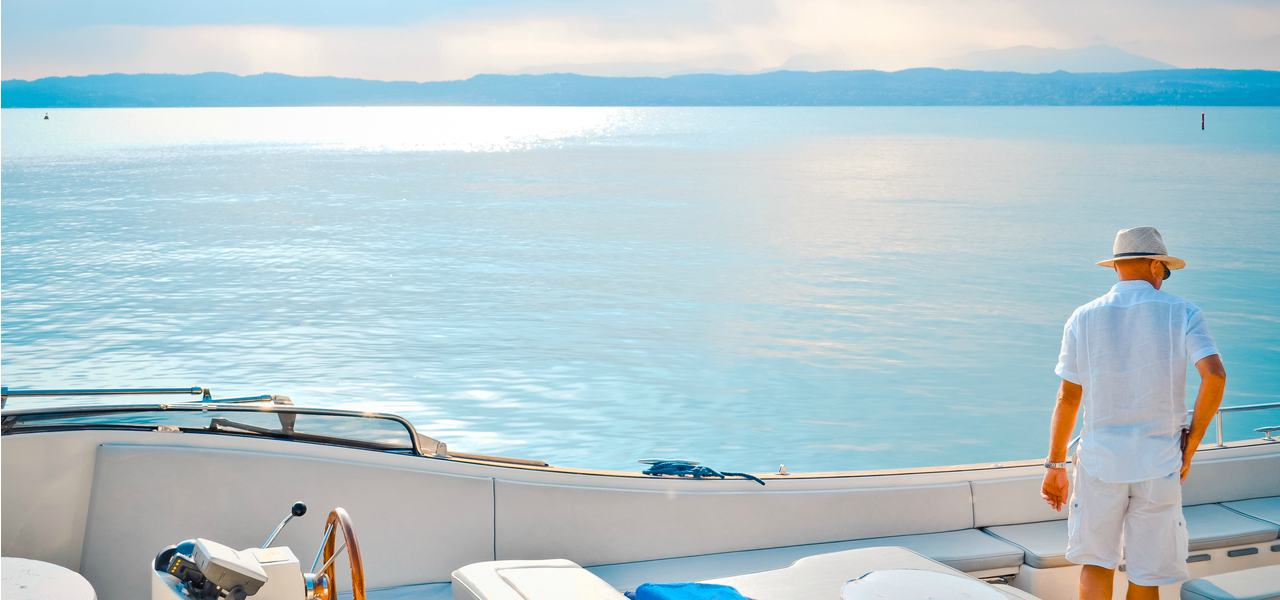 A man looking out to sea on a private yacht