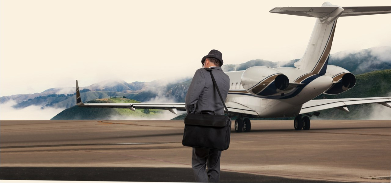 A man walking alone to a private plane