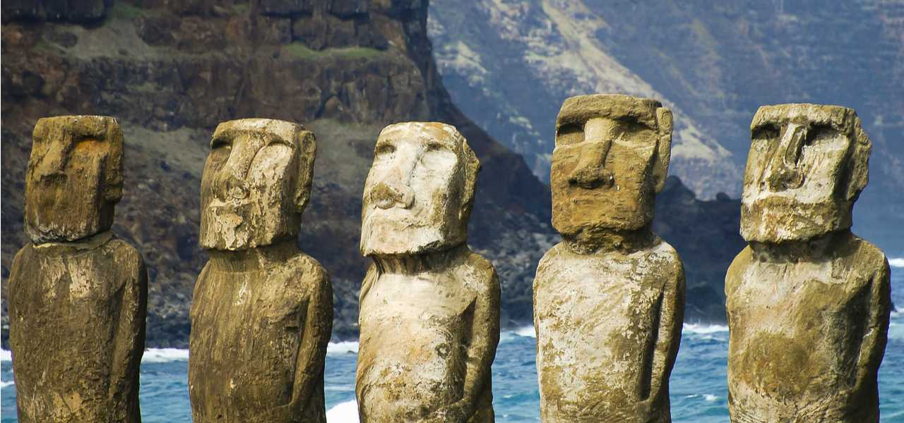 Moais of Ahu Tongariki on Easter Island, Chile, with pacific ocean and mountains in the background