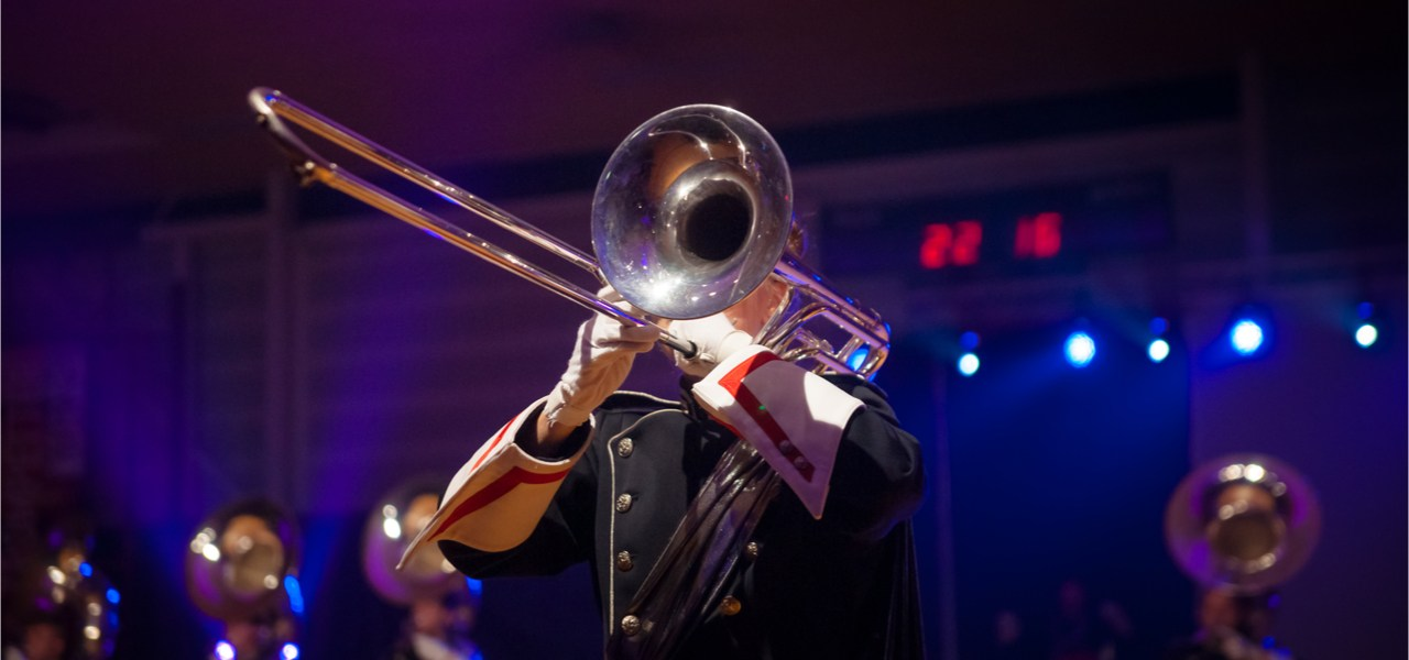 Jazz musicians in uniforms during a concert.