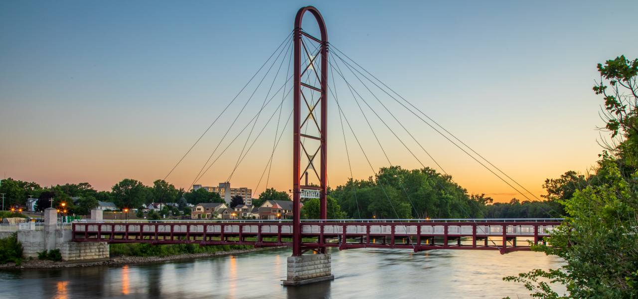 Sunset on a red bridge over a river in Northwest Indiana