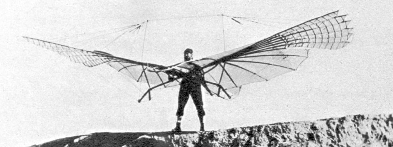 Otto Lilienthal with his small-wing ornithopter, near the Fliegeberg in 1894