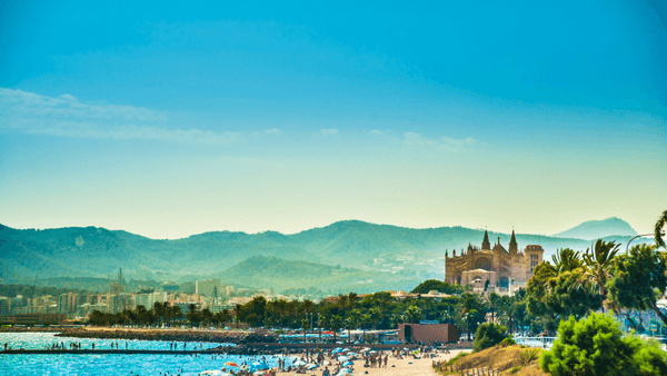 Palma de Mallorca beach with mountains in the background