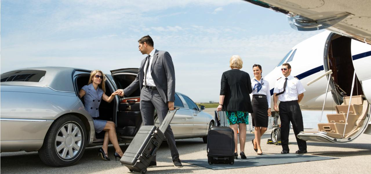 Business people boarding a private plane