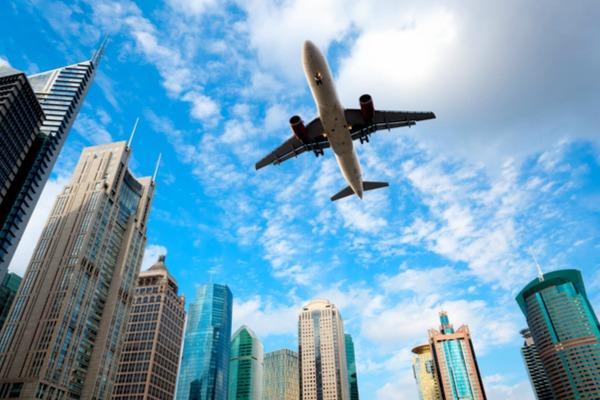 Plane flying over Shanghai city