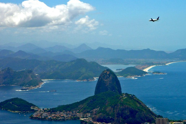 Plane flying over Sugar-Loaf mountain in Brazil