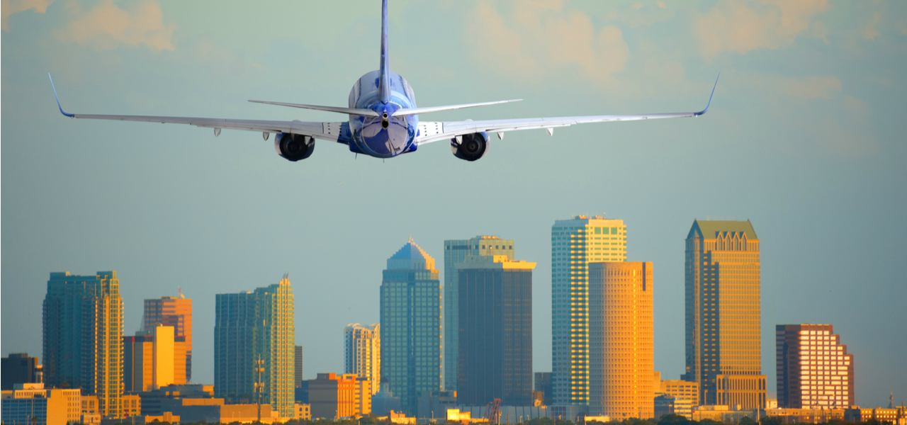 A plane flying over the Tampa, Florida, skyline