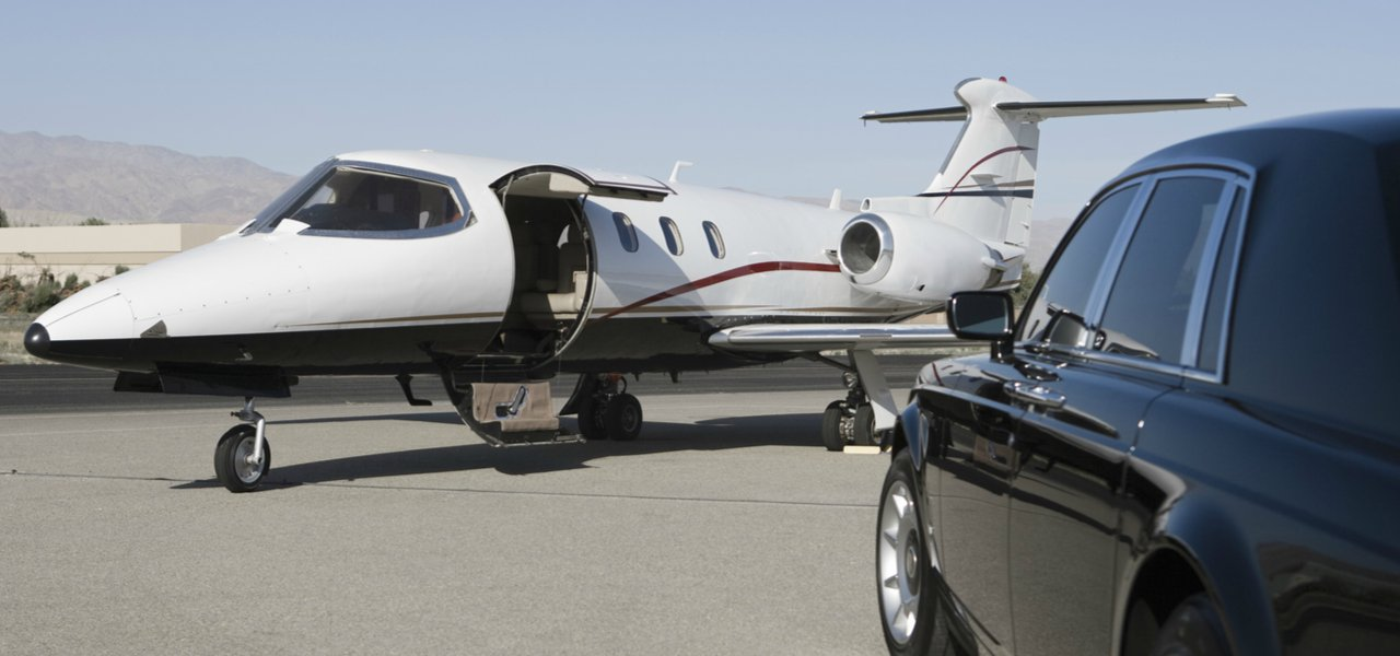 Private jet and car on runway