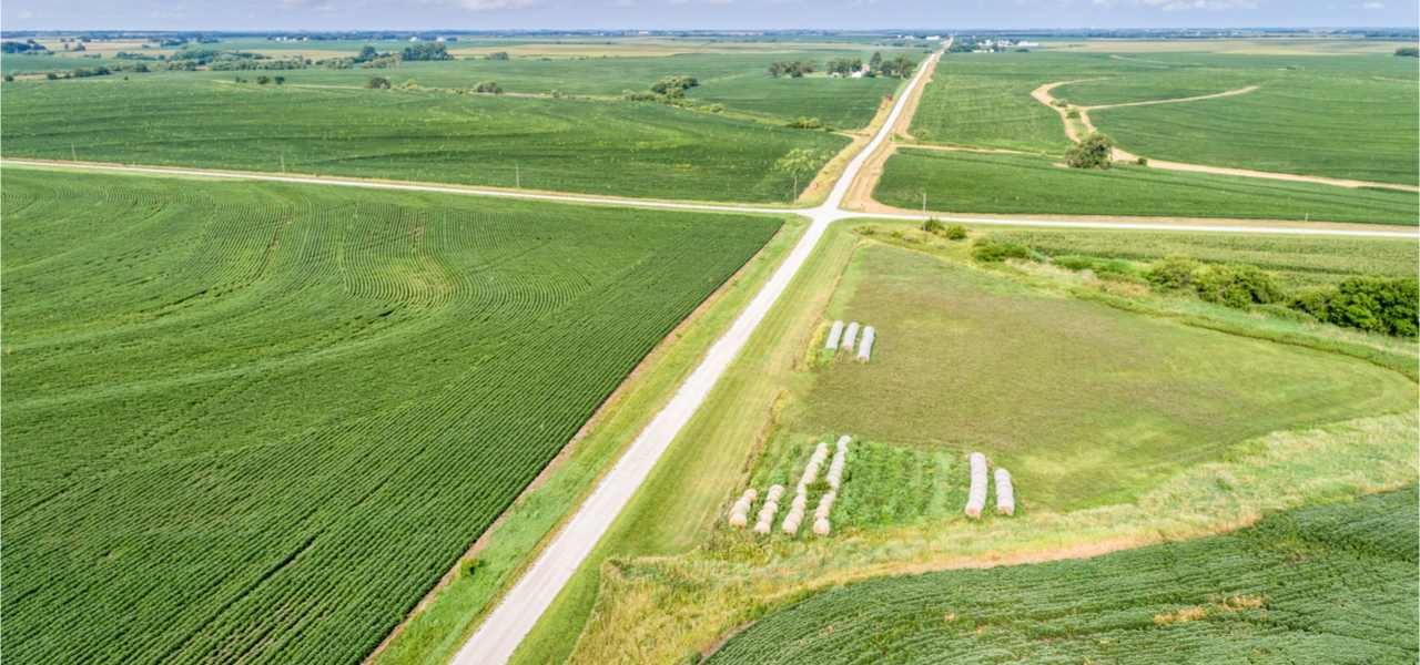 Aerial view of rural Nebraska landscape with a farm road