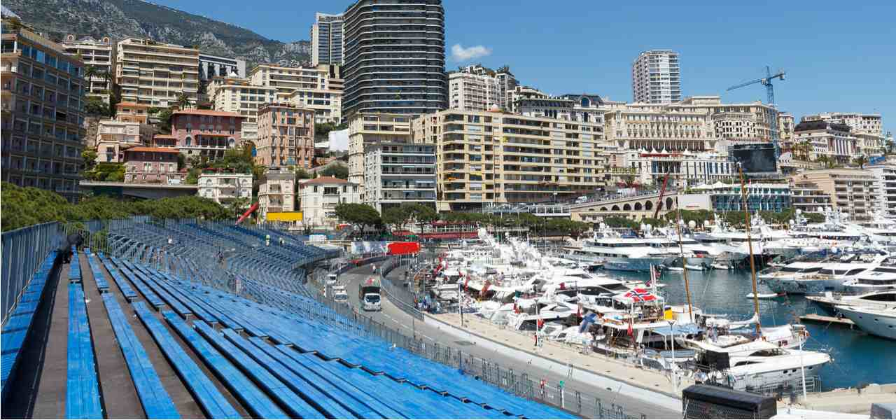 Audience stands at Monaco F1 track with harbour in the background