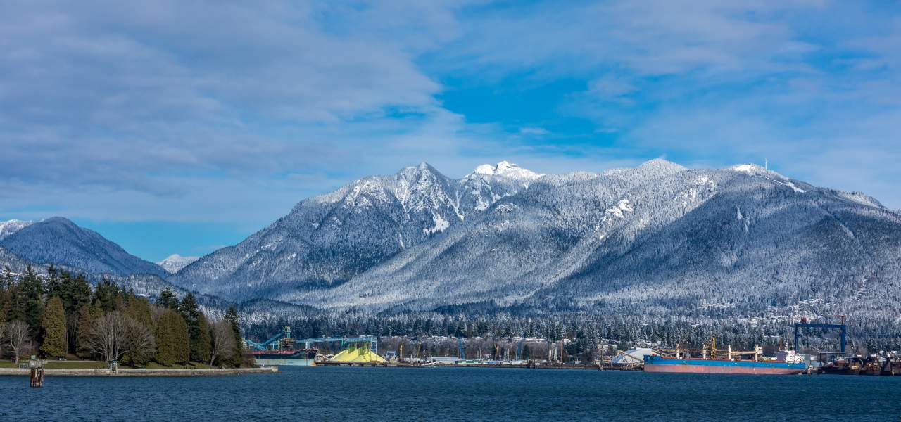 Tanker and Rocky Mountains in Vancouver, British Colombia
