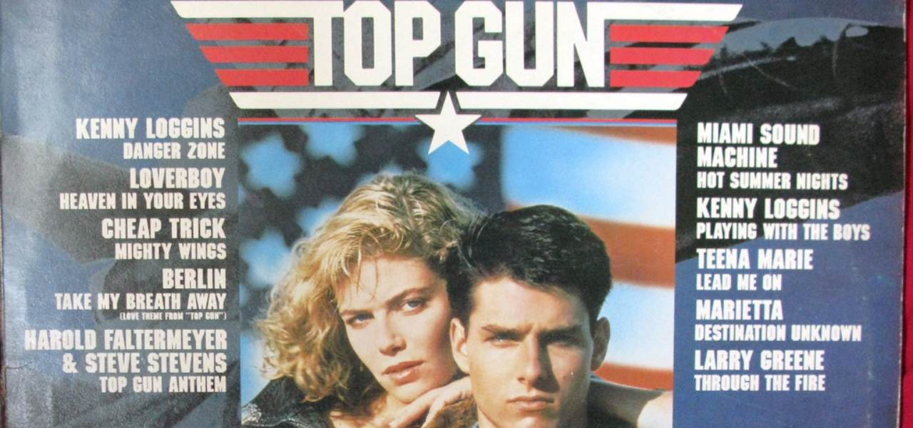 Old Top Gun Movie Poster with film stars Tom Cruise and Kelly McGillis in the centre