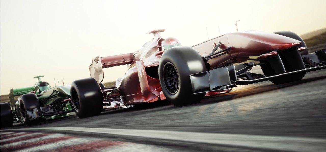 Two race cars racing down the main straight