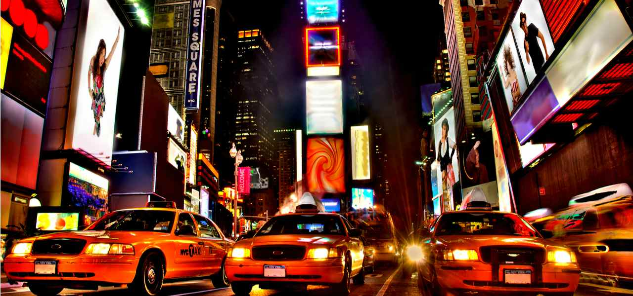 Times Square intersection with yellow cabs and billboards, USA