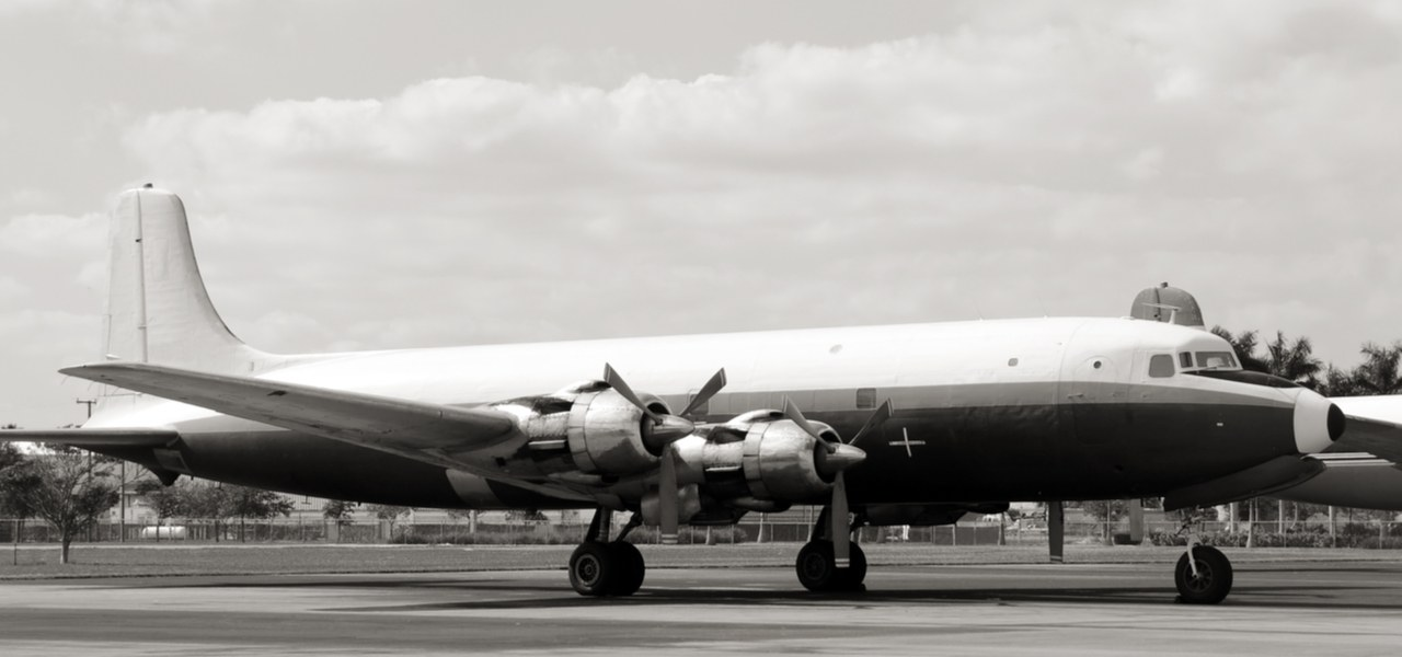 Vintage airliner from the 50s on the ground in black and white.