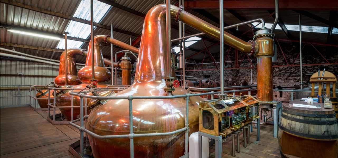 Copper stills inside a whisky distillery