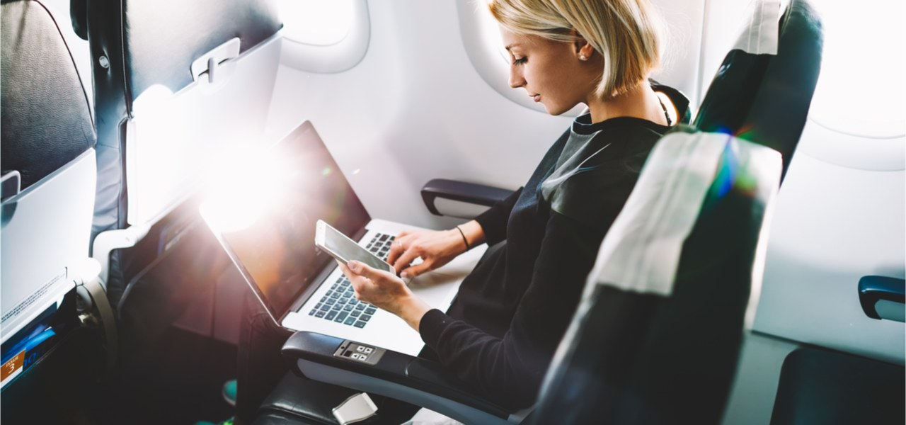 Young business woman during plane flight